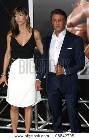 LOS ANGELES - NOV 19:  Jennifer Flavin, Sylvester Stallone at the