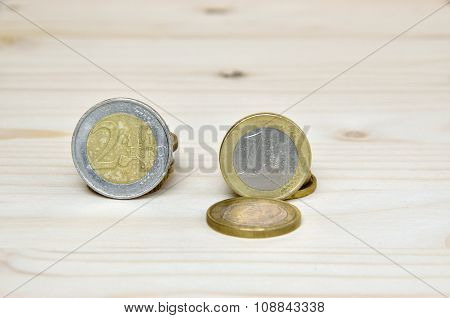 Euro Coins On Wooden Background