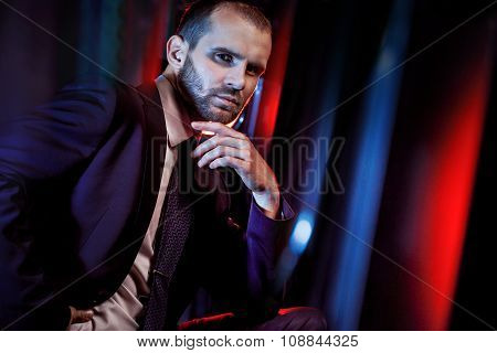 serious man in a business suit, dark background