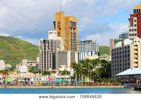 PORT LOUIS, MAURITIUS ISLAND - OCTOBER 30, 2015: Port Louis harbor with skyscrapers on city skyline on Mauritius Island.