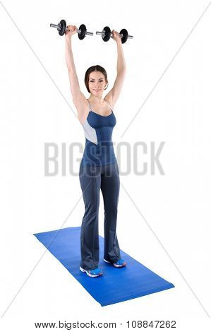 young woman fitness instructor shows finishing position of standing dumbbell shoulder press, isolated on white