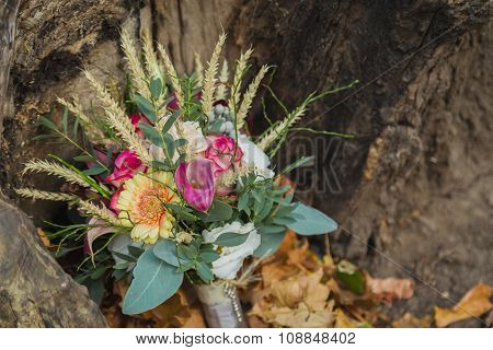 Wedding bouquet on the yellow leaves