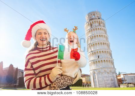 Mother In Christmas Hat And Daughter Holding Italian Flag. Pisa