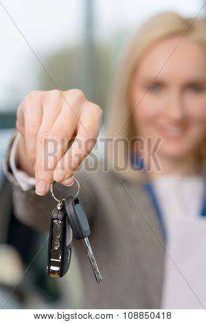 Saleswomans hand grasping the car keys.