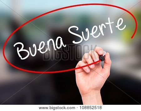 Man Hand writing Buena Suerte( Good Luck in Spanish) with marker on visual screen.