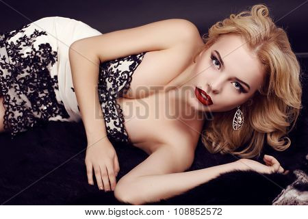 Gorgeous Woman With Blond Hair Wears Luxurious Party Dress And Bijou