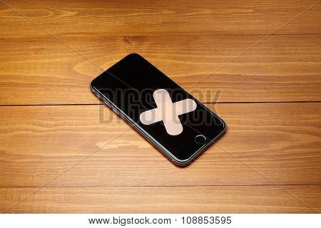 Repaired Smartphone With Bandage