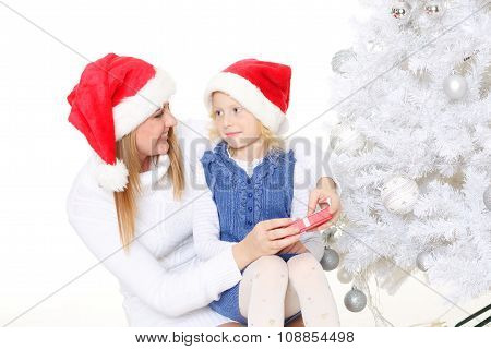 Happy Family With Christmas Gift.