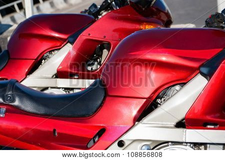 two attractive red sports motorbikes. close-up