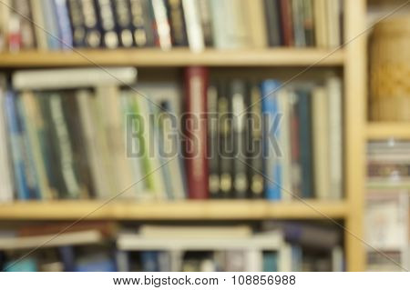 Blurred image of bookshelves with books