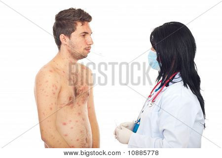 Doctor Taking Temperature To Sick Male
