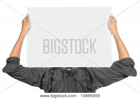 young man holding blank white board