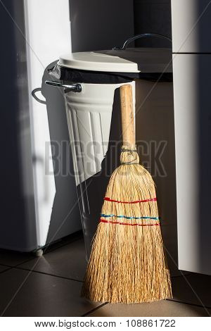 Broom And Dumpster