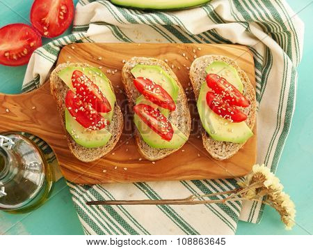 Sandwiches with avocado and tomatoes