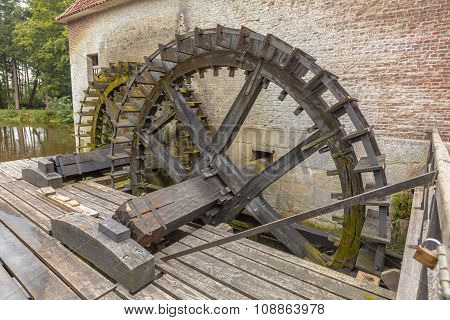 Paddle Wheels At A Watermill