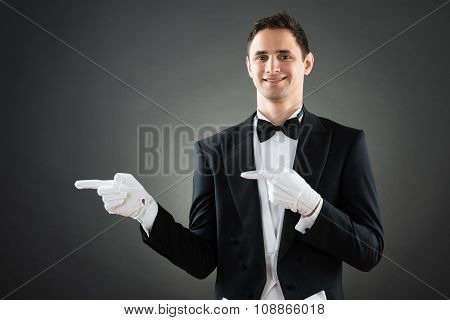 Confident Waiter Presenting Invisible Product