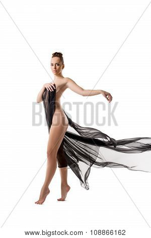 Nude. Sensual modern dancer posing on tiptoe