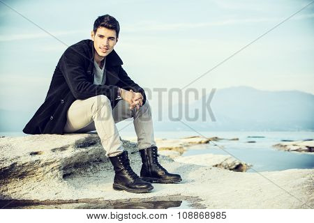 Attractive young man on a lake in a sunny