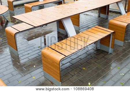 Wet Outdoor Cafe Tables On The Street After A Rain