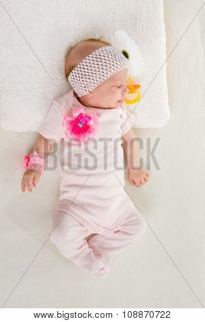 The Two-month Girl Sleeping On The Bed