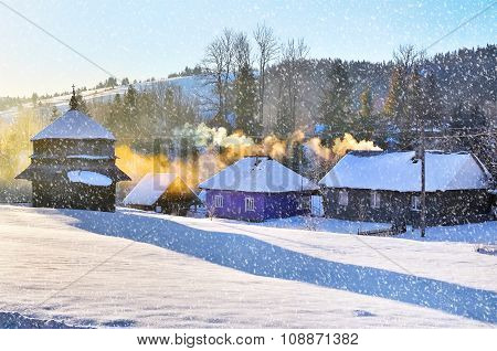 Winter landscape with snow in mountains. Beautifull snowfall. Carpathians, Ukraine