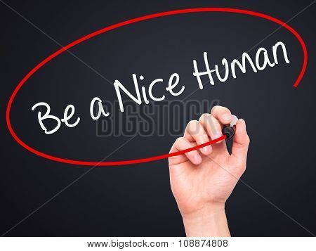 Man Hand writing Be a Nice Human with marker on visual screen.