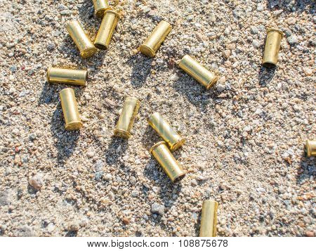 biathlon rifle scattered fired cartridges shining in the sun