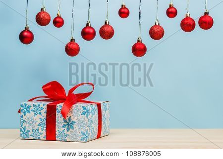 Gift In A Beautiful Package With A Red Ribbon