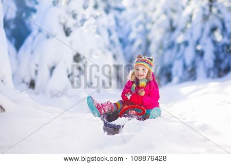 Little Girl Enjoying A Sleigh Ride.