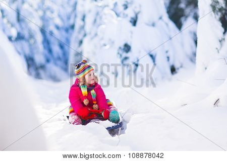 Little Girl In Snowy Forest