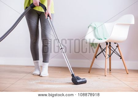 Maid Vacuuming Floor