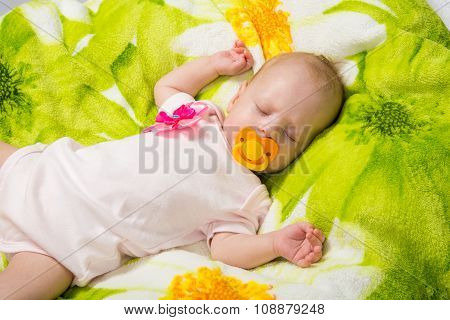 Sleeping Two-month Girl Sucking A Pacifier
