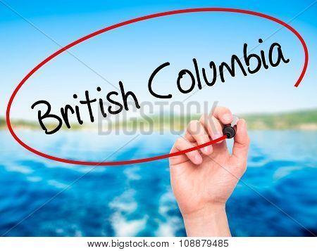 Man Hand writing British Columbia with black marker on visual screen.
