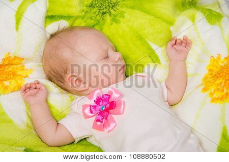 The Two-month Baby Carefree Sleeping On The Bed