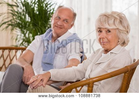 Elderly Man Looking At His Wife