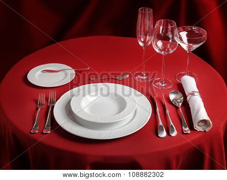 Professional Setting Of Red Dinner Table