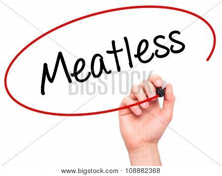 Man Hand writing Meatless with  marker on visual screen.