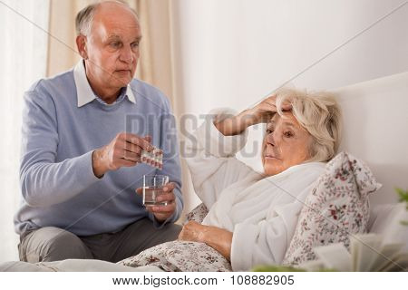 Man Giving His Sick Wife Pills