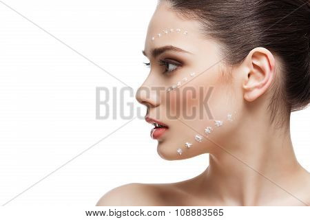 Girl with moisturizing cream