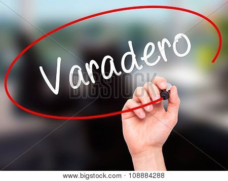 Man Hand writing Varadero with black marker on visual screen.