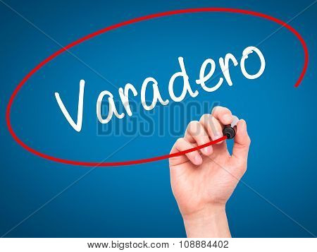 Man Hand writing Varadero with black marker on visual screen.