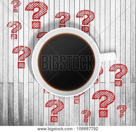 Top View Of A Cup Of Coffee And Red Drawn Question Marks Around It On The Wooden Table. 3D Rendering