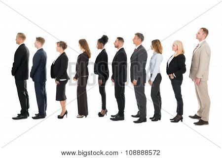 Side View Of Business Team Standing In Row