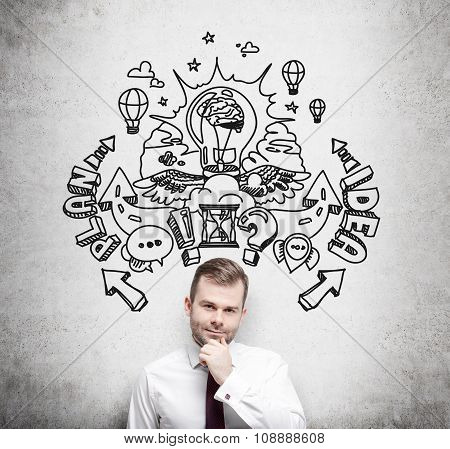 A Handsome Young Professional Is Forecasting A Building Of A Business Plan For Business Development.