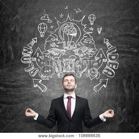 Meditative Businessman Is Dreaming About An Invention Of New Business Ideas For Business Development
