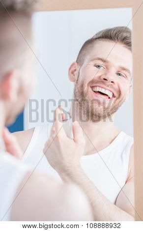 Handsome Man Applying Perfume