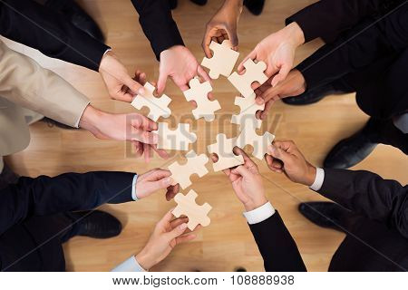 Business Team Joining Jigsaw Pieces