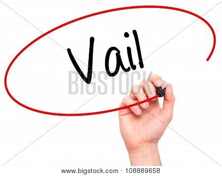 Man Hand writing Vail with black marker on visual screen.