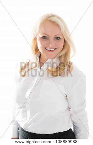Hostess Standing Against White Background