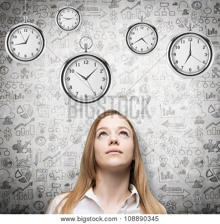A Portrait Of A Beautiful Lady Who Is Looking At The Hovering Pocket Watches. A Concept Of A Value O